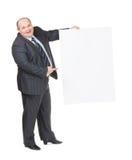 Uomo di peso eccessivo allegro con un segno in bianco Immagine Stock