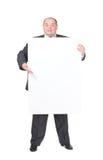 Uomo di peso eccessivo allegro con un segno in bianco Fotografia Stock Libera da Diritti