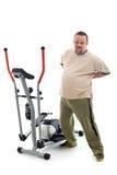 Uomo di peso eccessivo che allunga suo indietro Fotografia Stock