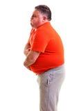 Uomo di peso eccessivo con forte mal di stomaco fotografia stock libera da diritti