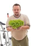 Uomo di peso eccessivo non felice circa la sua nuova dieta fotografia stock libera da diritti