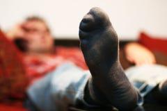 Uomo di pigrizia che raffredda fuori Fotografie Stock Libere da Diritti