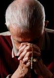 Uomo di preghiera immagini stock
