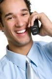 Uomo di risata del telefono Immagini Stock
