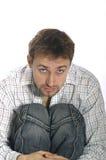 Uomo di seduta Immagini Stock Libere da Diritti