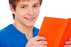 Uomo di smiley con il libro Fotografia Stock