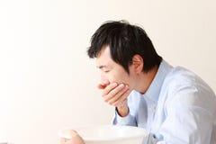 Uomo di vomito Fotografia Stock
