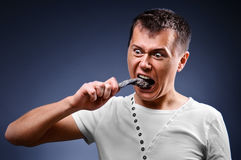 Uomo diabolico affamato Fotografia Stock