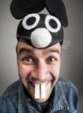 Uomo divertente in cappello del mouse Fotografia Stock
