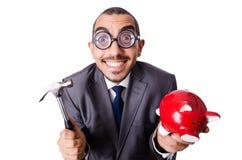 Uomo divertente che rompe il suo porcellino salvadanaio Immagini Stock Libere da Diritti