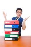 Uomo divertente con i lotti delle cartelle Fotografia Stock