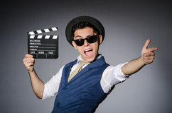 Uomo divertente con il film fotografie stock libere da diritti