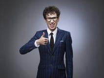 Uomo divertente con il pollice su Fotografie Stock