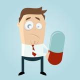 Uomo divertente del fumetto con la grande pillola Fotografie Stock Libere da Diritti