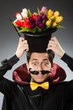 Uomo divertente del mago con la bacchetta Fotografia Stock