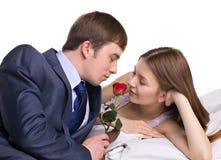 Uomo, donna e fiore rosso Fotografia Stock