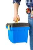 Uomo e cassetta portautensili con l'insieme degli strumenti Immagine Stock
