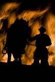 Uomo e cavallo in fiamme Fotografie Stock Libere da Diritti
