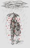 Uomo e donna che camminano nella pioggia Immagini Stock Libere da Diritti