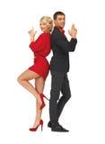 Uomo e donna che fanno un gesto della pistola Fotografie Stock