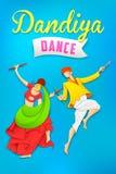 Uomo e donna che giocano dandiya che balla Garba Fotografie Stock