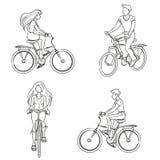 Uomo e donna che guidano una bicicletta Fotografia Stock Libera da Diritti