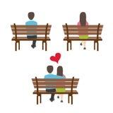 Uomo e donna che si siedono vista posteriore Immagine Stock