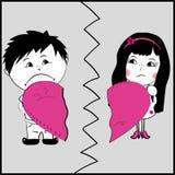 Uomo e donna che tengono parte di un cuore rotto Immagine Stock