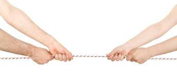 Uomo e donna che tirano una corda Fotografia Stock Libera da Diritti