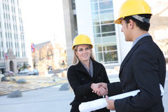 Uomo e donna della costruzione di affari Immagini Stock Libere da Diritti