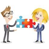 Uomo e donna di affari con i pezzi del puzzle illustrazione di stock