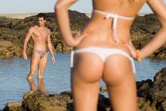 Uomo e donna nella spiaggia Fotografia Stock