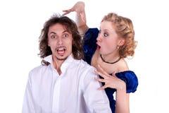 Uomo e donna piacevoli in un vestito nero e blu Fotografie Stock