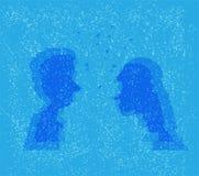 Uomo e donna sotto il vischio di natale Immagine Stock