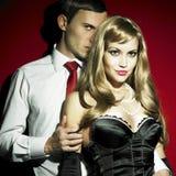 Uomo e donna, in vestiti sessuali Fotografie Stock
