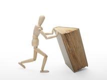 Uomo e libro di legno Immagine Stock Libera da Diritti