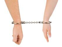 Uomo e mani e manette della donna Fotografia Stock Libera da Diritti