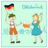 Uomo e ragazza con birra e la bandiera della Germania Immagini Stock