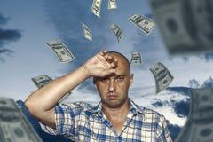 Uomo e soldi immagine stock