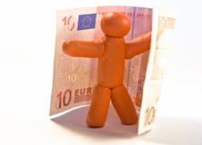 Uomo e soldi del Plasticine Fotografia Stock