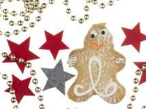 Uomo e stelle di pan di zenzero di Natale Fotografia Stock
