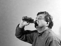 Uomo e wiskey Fotografie Stock Libere da Diritti