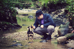 Uomo ed il suo cane Fotografie Stock