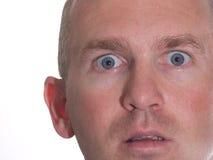 Uomo Eyed blu stupito Immagini Stock