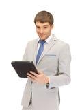 Uomo felice con il computer del pc della compressa Fotografia Stock