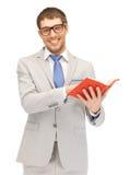 Uomo felice con il libro Immagine Stock Libera da Diritti