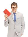 Uomo felice con il libro Fotografia Stock