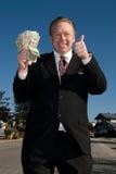 Uomo felice con il wad di contanti. Fotografia Stock