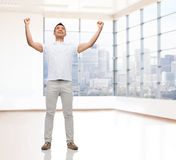 Uomo felice con le mani sollevate Immagine Stock Libera da Diritti