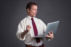 uomo felice del computer portatile Fotografie Stock Libere da Diritti